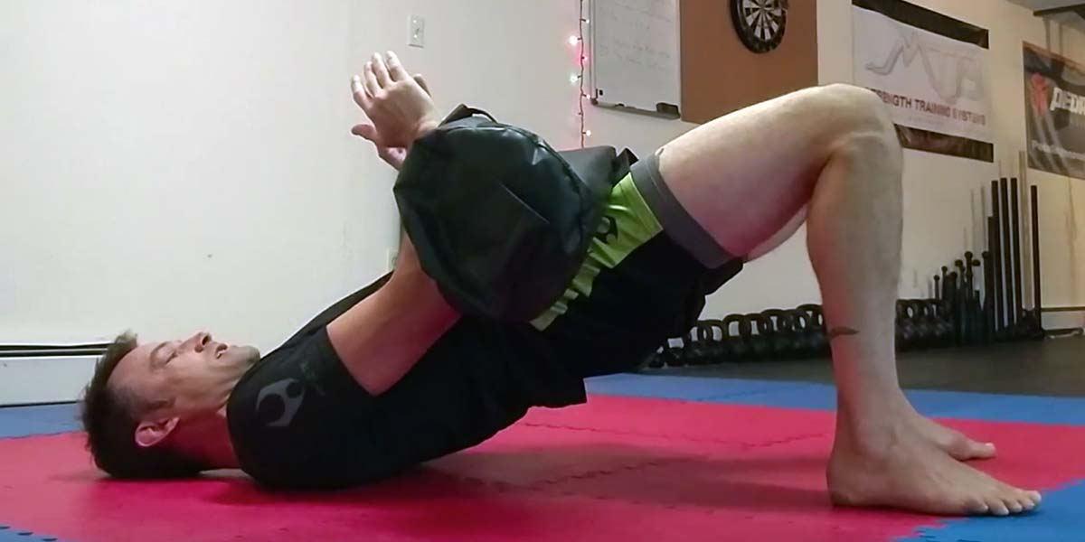 Using Sandbags to Improve Your Hip Strength and for Better Bridging on the Mats